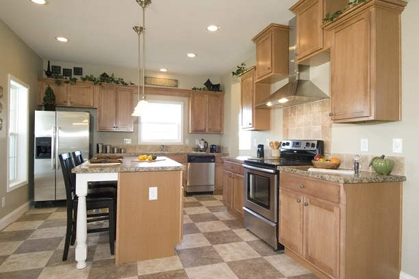 Ashton II Modular Home Kitchen with large checkered vinyl tile and stainless steel appliances