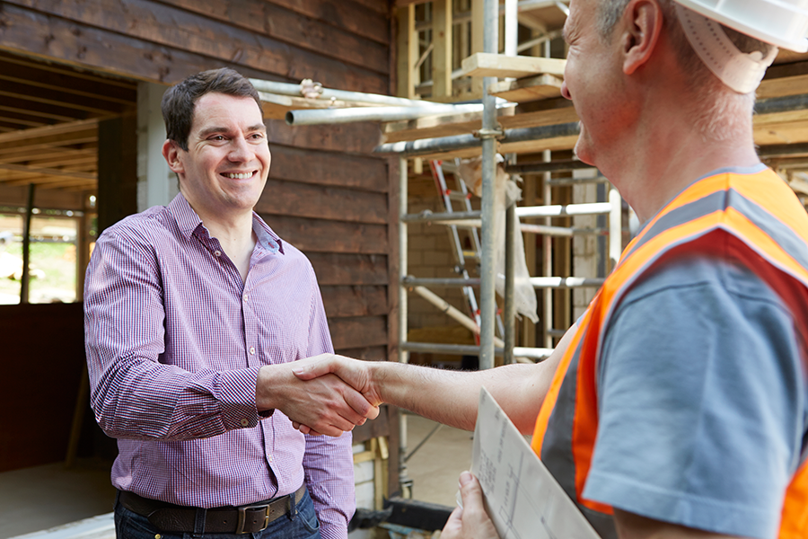 man shaking hands with a construction worker